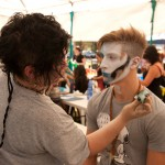 Nina Megaloconomos starting her face painting on Jesse.