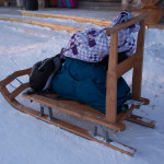 Osprey Farpoint 55, a stuffable daypack, and a spare jacket on a sled at Hotel Kakslauttanen