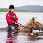 Horseback Riding Across the River