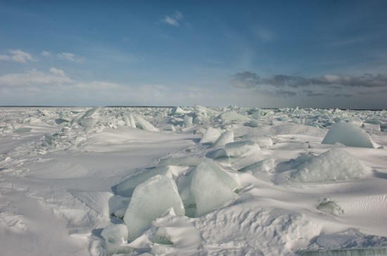 Blocks of ice scattered everywhere at the edge of the pack ice. The open Gulf of Bothnia can be seen in the distance.